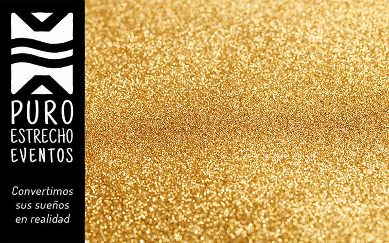 Abstract bokeh background with shining gold glitters.